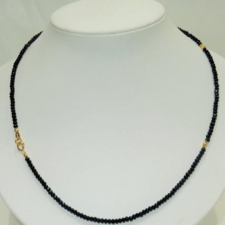 Girollo unisex con spinelli neri e Oro giallo 18kt-750%.